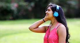 Student relaxing with headphones