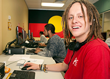 Indigenous student working on computer