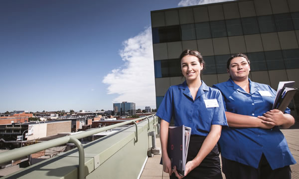 Nursing students standing on a rooftop